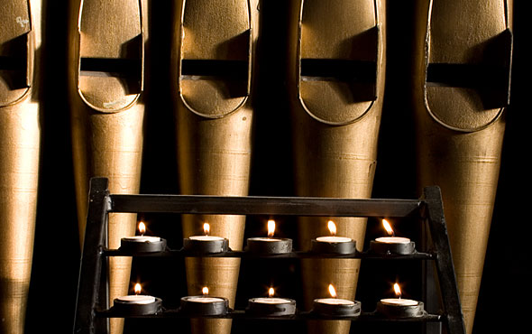 Votive Candles in front of the organ pipes.